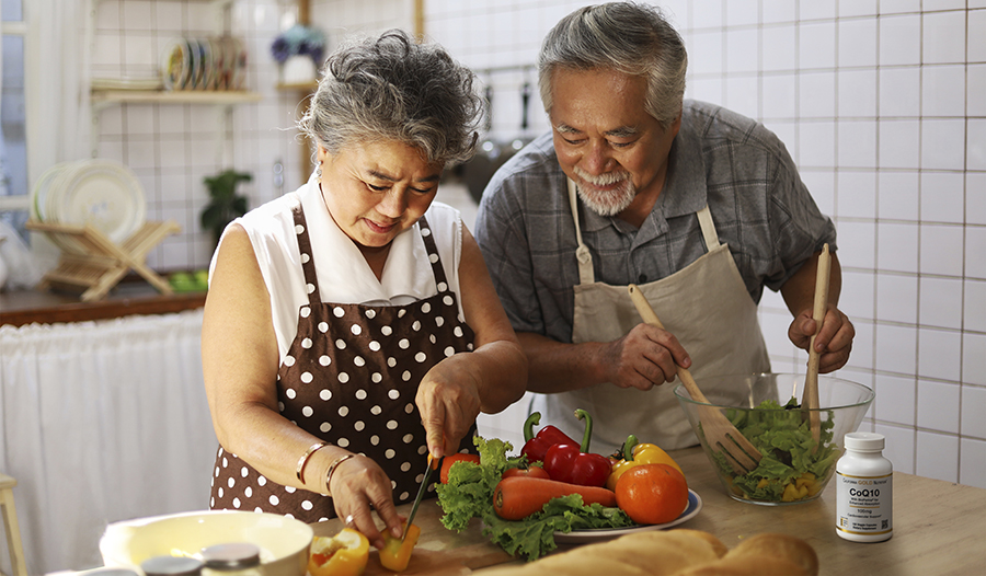 Mature couple making healthy meal in their kitchen