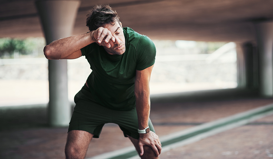 Male athlete taking a break from a tough workout