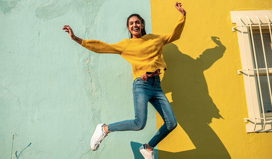 woman jumping in the air thinking about her top rated self-care products