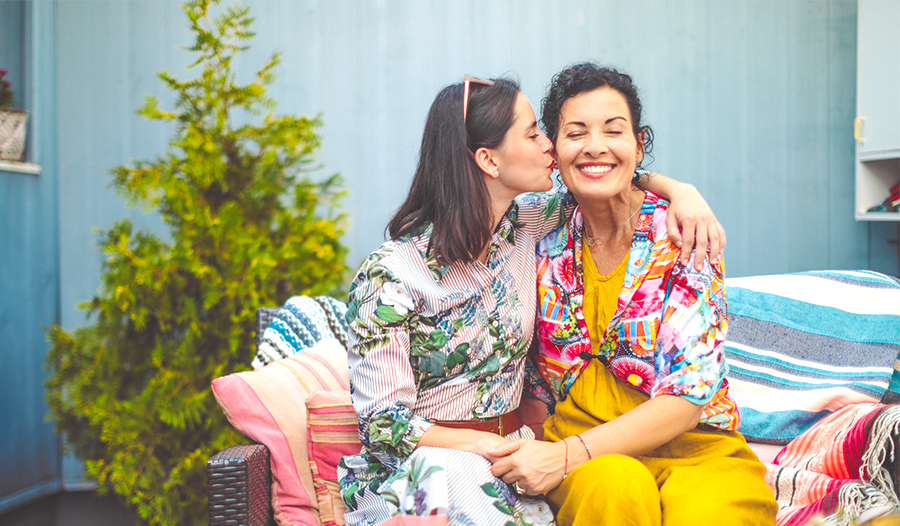 daughter kissing mother on the cheek for mother's day